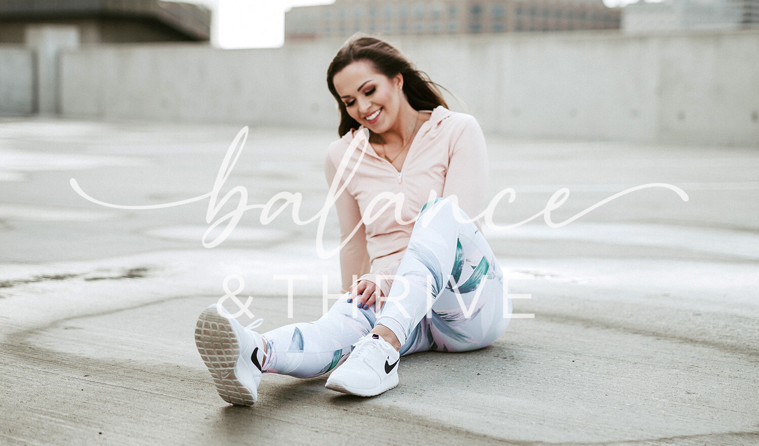 Lynette sitting in gym clothes with Balance + Thrive logo ove the top